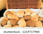 a lot of bread buns in wooden...   Shutterstock . vector #1219717984