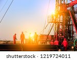 the oil workers are working | Shutterstock . vector #1219724011