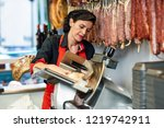 female butcher cutting york ham ... | Shutterstock . vector #1219742911