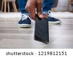 man's hand picking up mobile... | Shutterstock . vector #1219812151