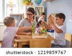 preschool teacher with children ... | Shutterstock . vector #1219859767