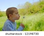 a cute boy is blowing a... | Shutterstock . vector #12198730