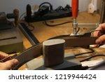 man hands bending a wooden...   Shutterstock . vector #1219944424