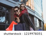 happy couple shopping together... | Shutterstock . vector #1219978351