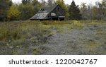 old wood barn in a grass field... | Shutterstock . vector #1220042767