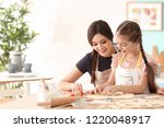 mother and daughter with cookie ... | Shutterstock . vector #1220048917