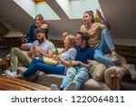 friends watching football game | Shutterstock . vector #1220064811