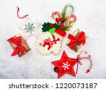 christmas mitten with candy... | Shutterstock . vector #1220073187