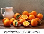 fresh orange fruits with leaves ... | Shutterstock . vector #1220103931