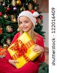cute little girl holding her... | Shutterstock . vector #122016409