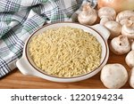 a bowl of raw orzo pasta with... | Shutterstock . vector #1220194234
