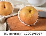 a delicious ripe apple pear on... | Shutterstock . vector #1220195017