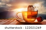 Stock photo cup of tea at sunset 122021269