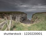 Wooden Fence On Cliff Edge And...