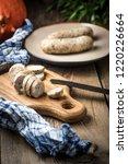 sliced tasty white sausage.... | Shutterstock . vector #1220226664