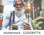 happy senior man listening... | Shutterstock . vector #1220284774