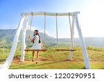 smiling young woman relaxing by ... | Shutterstock . vector #1220290951