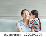 happy asian child girl sharing... | Shutterstock . vector #1220291104