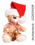 Teddy Bear with Santa Hat and Christmas Decoration / Christmas Time - stock photo