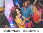 group of friends dancing and...   Shutterstock . vector #1220306077