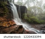 Fog and mist at Weeping Rock in the upper section of Wentworth Falls during a chilly winter day