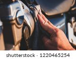 hand polishing the side of a... | Shutterstock . vector #1220465254