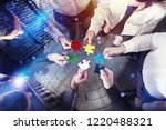 business people join puzzle... | Shutterstock . vector #1220488321