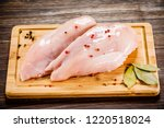 raw chicken breasts on cutting... | Shutterstock . vector #1220518024