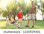 happy family having picnic in... | Shutterstock . vector #1220529301