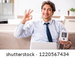 man under stress measuring his... | Shutterstock . vector #1220567434