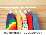 collection of warm sweaters... | Shutterstock . vector #1220604034