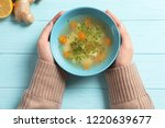 sick woman holding bowl of... | Shutterstock . vector #1220639677