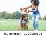 happy african family having fun ... | Shutterstock . vector #1220680501