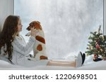 little girl embracing her puppy ... | Shutterstock . vector #1220698501