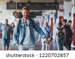 cheerful smiling stylish man... | Shutterstock . vector #1220702857