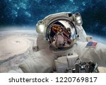astronaut in outer space... | Shutterstock . vector #1220769817