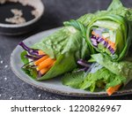 rolls from lettuce leaf with... | Shutterstock . vector #1220826967