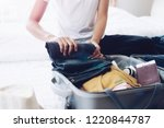 woman packing travel bag for... | Shutterstock . vector #1220844787