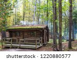 log cabin in autumn forest | Shutterstock . vector #1220880577