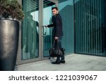 handsome young businessman with ... | Shutterstock . vector #1221039067