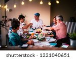 dinner time in friendship with... | Shutterstock . vector #1221040651
