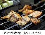 fish barbecue on skewers frying ... | Shutterstock . vector #1221057964