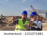 two satisfied engineers talking ... | Shutterstock . vector #1221071881