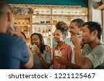 diverse group of young friends... | Shutterstock . vector #1221125467