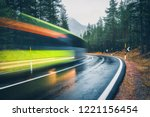 blurred green bus on the road... | Shutterstock . vector #1221156454