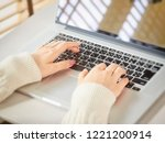 women's hand who operates a... | Shutterstock . vector #1221200914