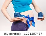 woman in pregnant with blue... | Shutterstock . vector #1221257497