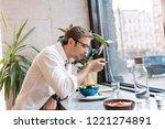 break in cafeteria. dark haired ...   Shutterstock . vector #1221274891