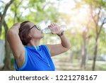 senior asian woman drinking...   Shutterstock . vector #1221278167