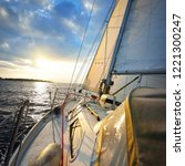 sailing at sunset. a view from... | Shutterstock . vector #1221300247